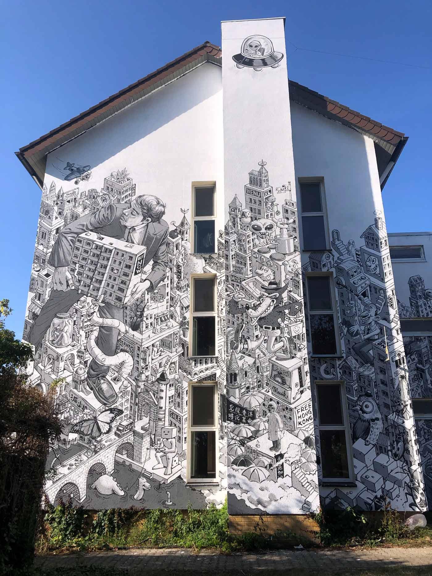 schwarz-weißes Graffiti an Hauswand